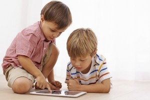 Kids-playing-on-digital-tablet-device